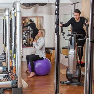 Two people exercising in The Movement Studio