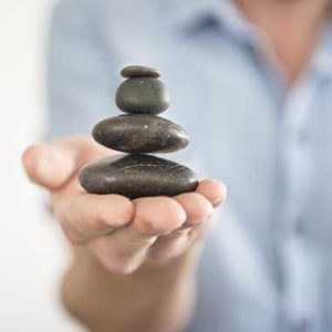 balancing stones in the right hand