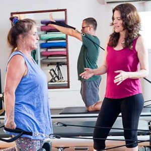 Mary Gorman PT with clients doing integrative physical therapy
